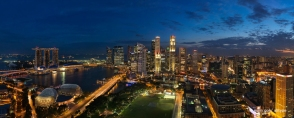 Panoramic view of Singapore skyline - Marina Bay and the Financial Centre (CBD) in the evening.