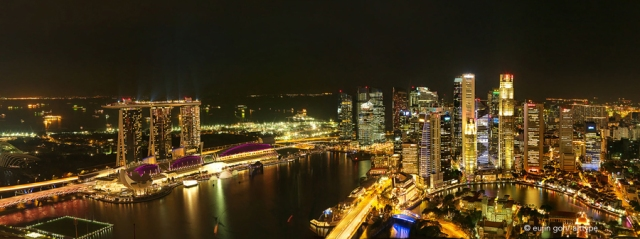 Panoramic view of Singapore skyline, Marina Bay and the Financial Centre (CBD) at night.  © Eujin Goh/alt.TYPE